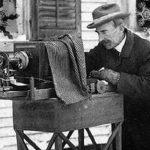 Wilson A Bentley at his camera to photograph snowflakes.