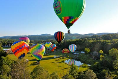 Hot Air Balloons over Vermont Hills.