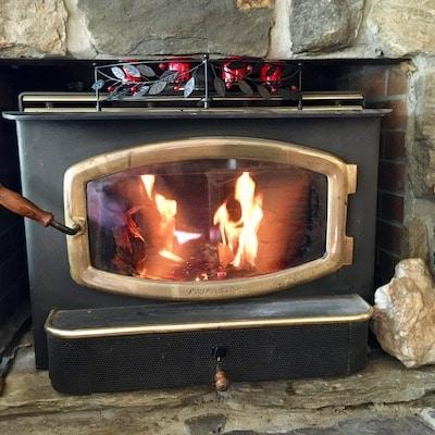 Fire in fieldstone fireplace